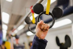 hand holding Mickey hand grip at Hong Kong Disney