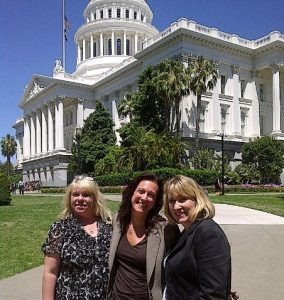 Paula Dana Anne in front of CA state capitol building