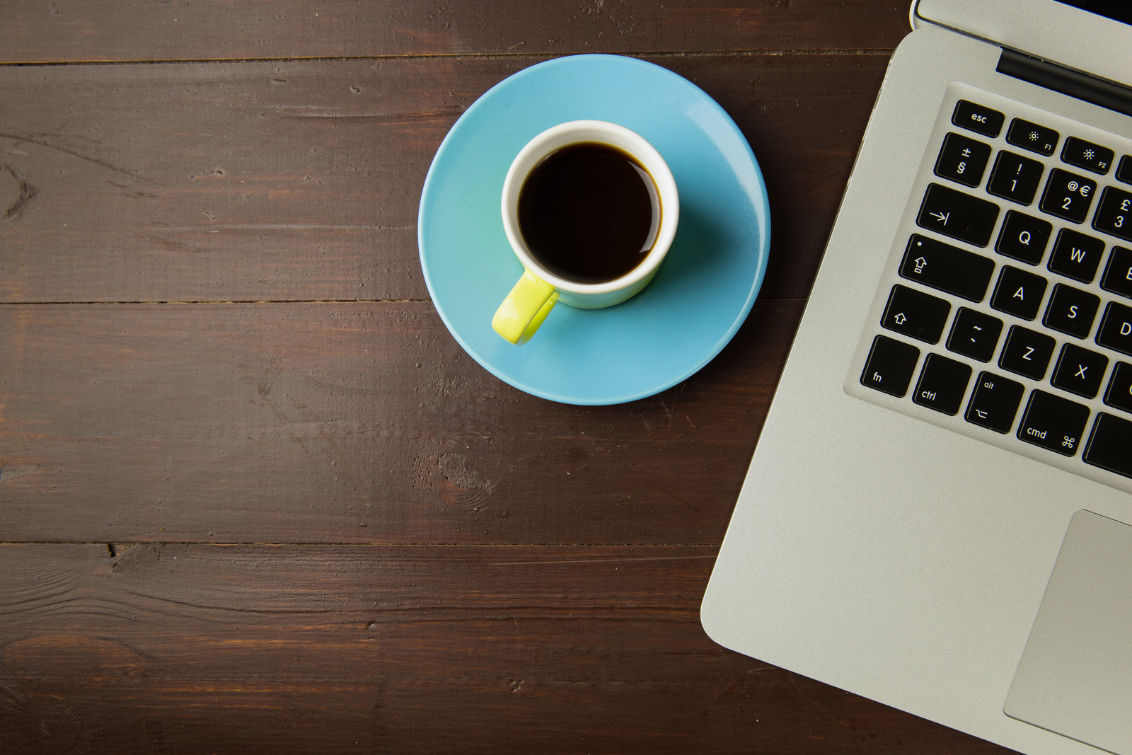 Cup of coffee and a computer