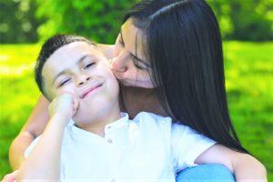 Mom kissing boy