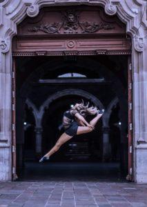 Dancing leaping in a doorway