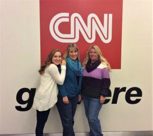 Jillian Anne Paula in front of a CNN sign