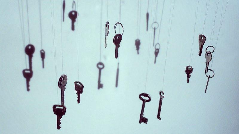 Many keys hanging on strings