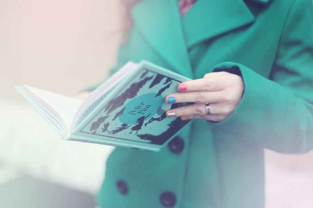 Woman Reading Peter Pan book