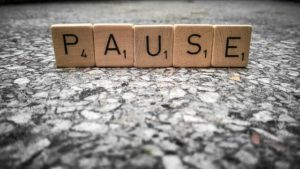 Scrabble letters that say PAUSE