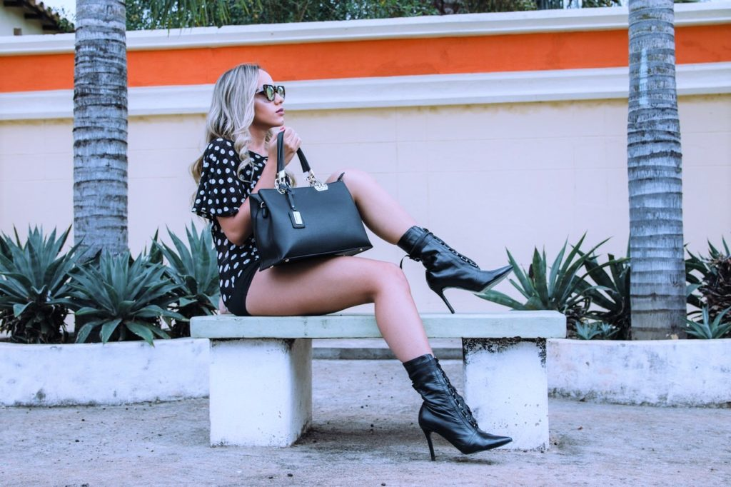 Model with a purse and boots