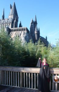 Photo of a child in front of Harry Potter Hogwarts Castle at Universal Studios