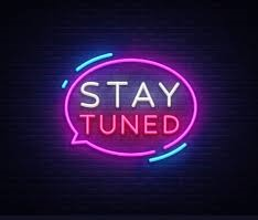 neon sign saying STay Tuned