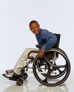 Craig Lamar Traylor in a wheelchair