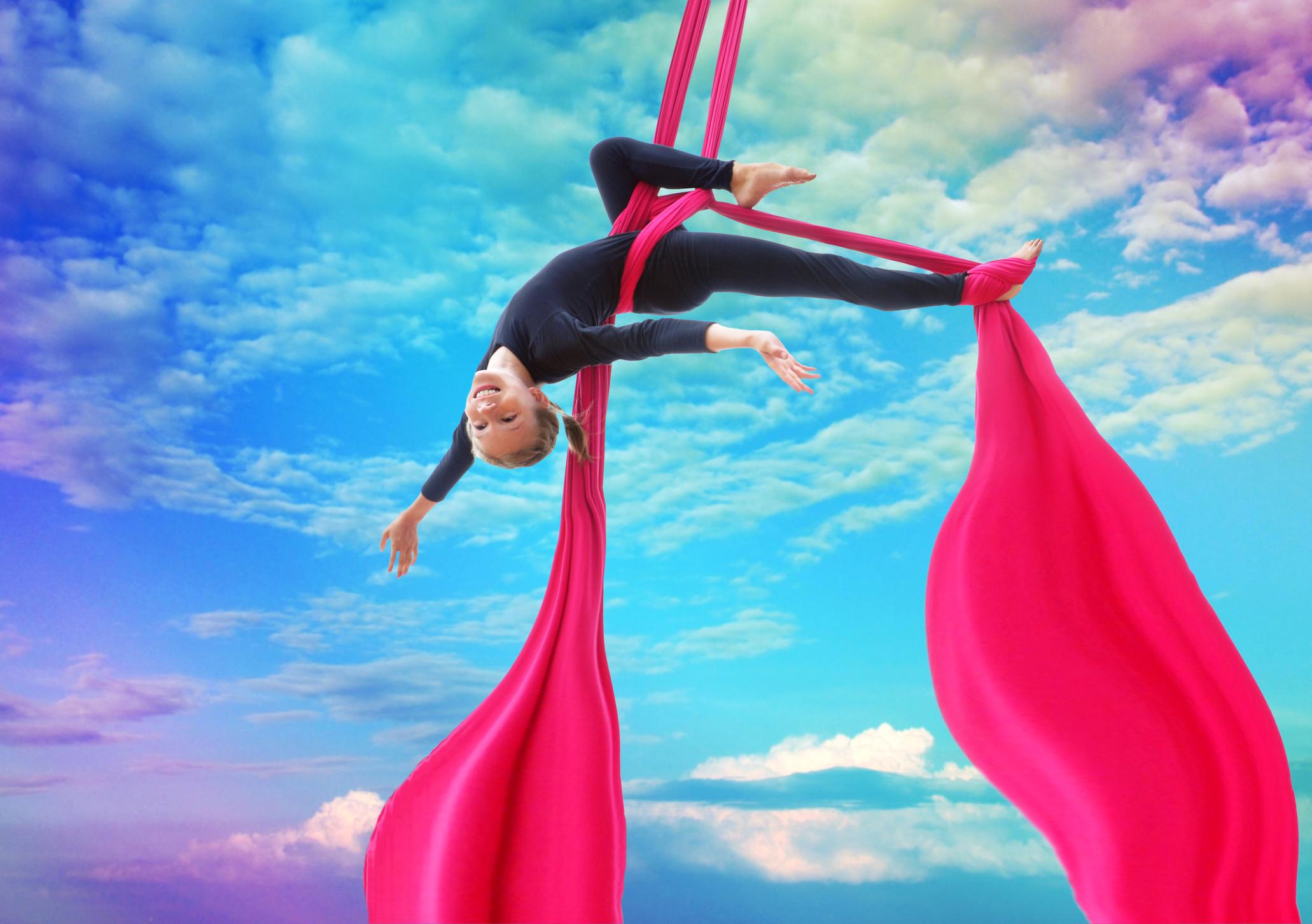 child on silk hanging upside down