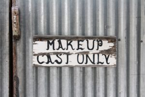 sign saying makeup cast only