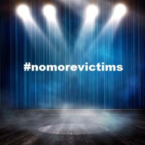 blue stage with #nomorevictims text