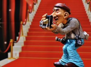 figurine of a photographer on a red carpet