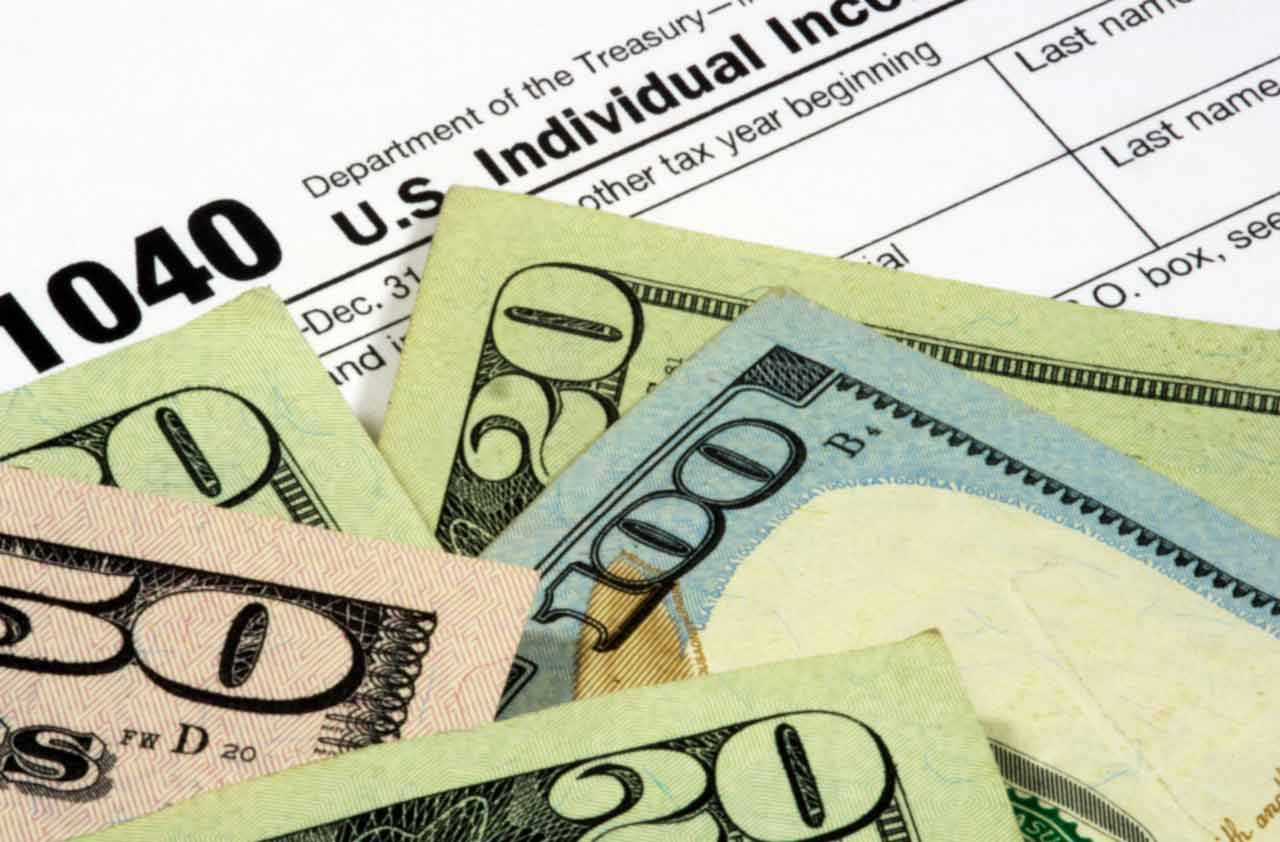 tax form with cash