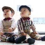 twin asian babies sitting down