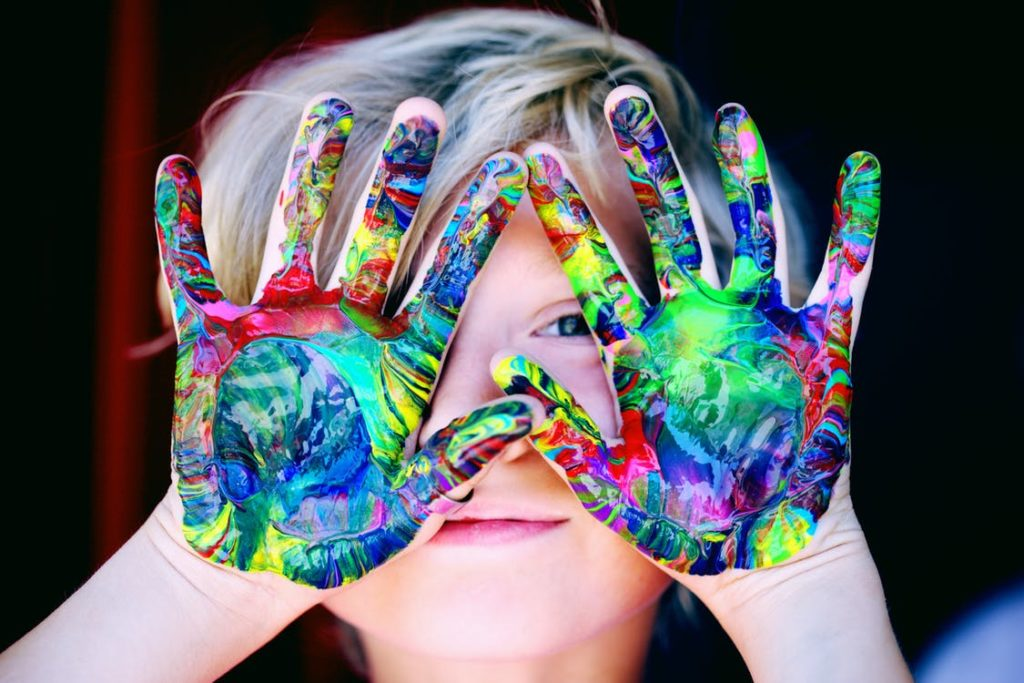 Kid with messy painted hands