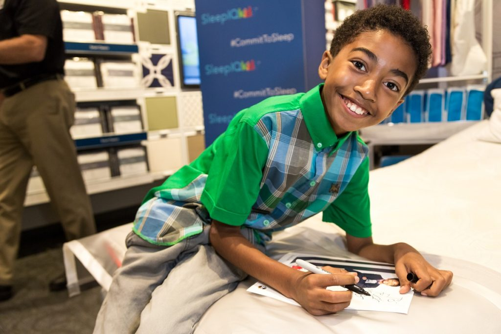 Miles Brown from Blackish signing autographs